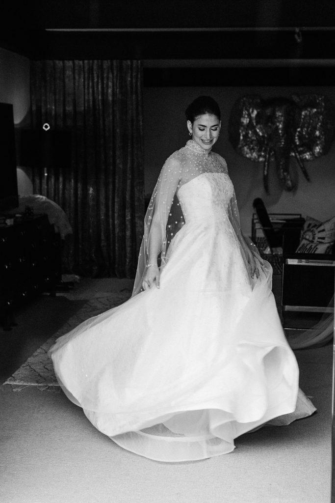 Bride in wedding dress dancing